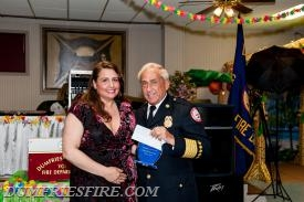 LT Gabriella Jennings receiving 2015 Firefighter of the Year award from Chief Young